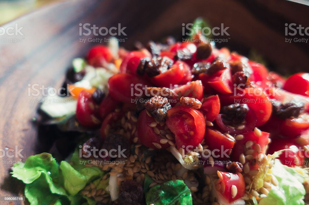 Summer salad in a wood bowl royalty-free stock photo