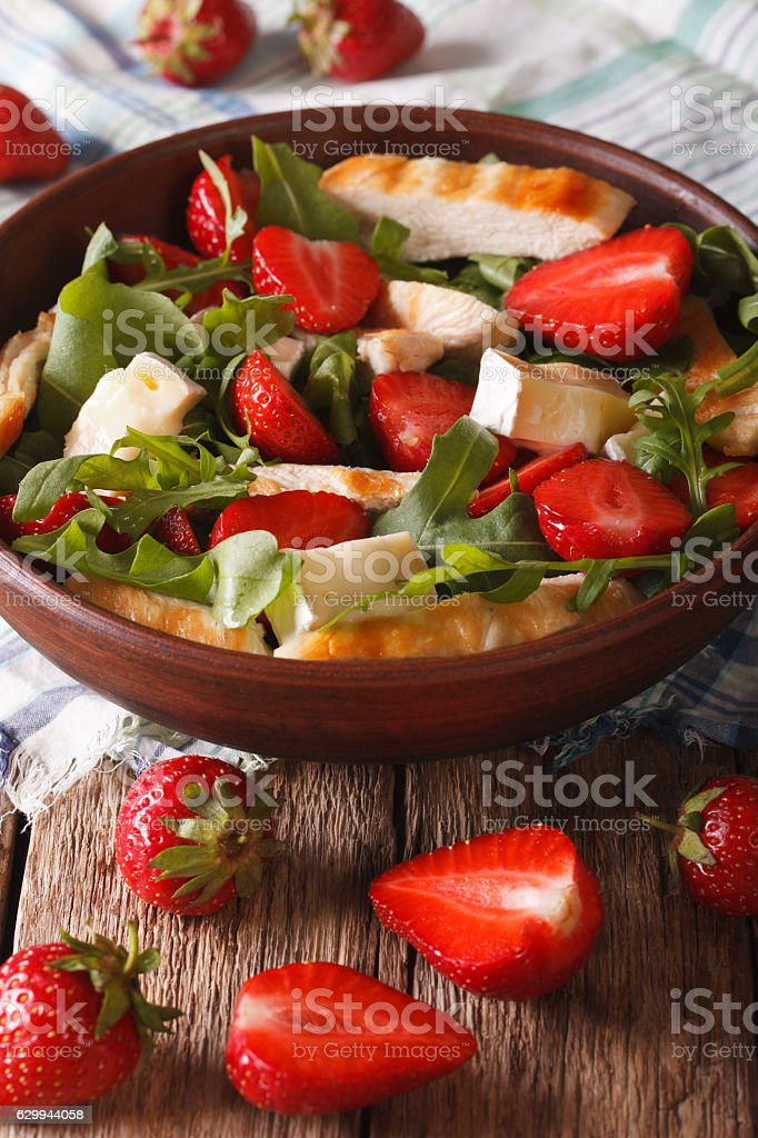 Summer salad with strawberries, grilled chicken, brie and arugula stock photo