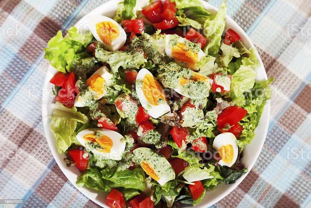 Summer salad with tomatos and boiled eggs royalty-free stock photo
