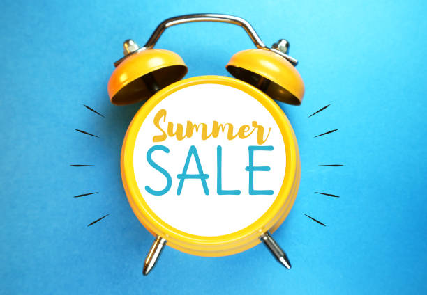 Summer sale concept. Alarm clock with sale message. stock photo