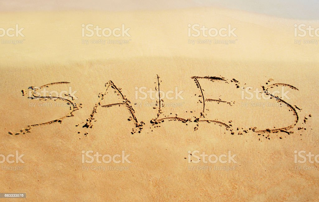 summer sales written on sand royalty-free stock photo