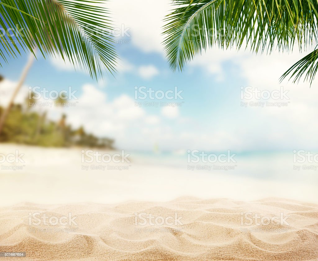 Summer sandy beach with blur ocean on background stock photo