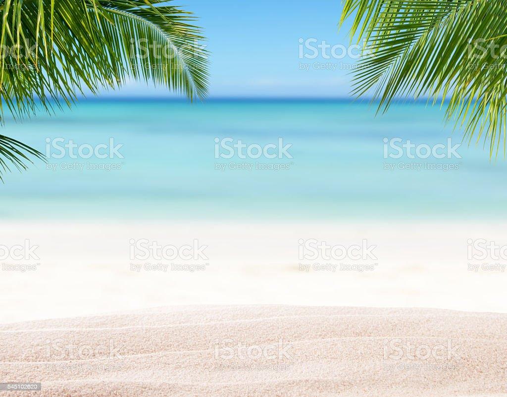Summer sandy beach with blur ocean on background stock photo