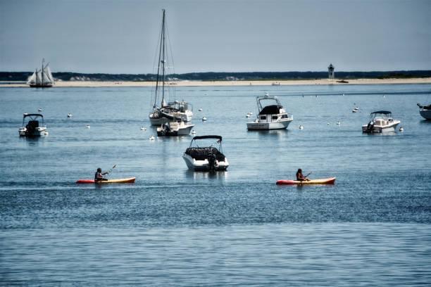 Summer scene, Kayaking at Provincetown Harbor, Cape Cod, Massachusetts, USA stock photo