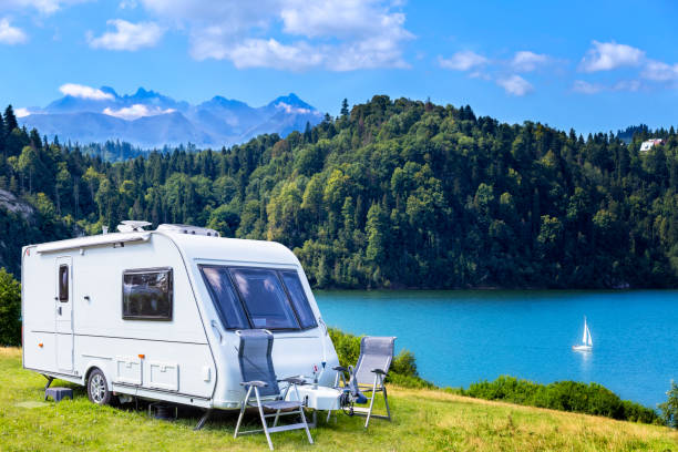 Summer scene with Czorsztyn lake and Tatra Mountains landscape, Poland Summer scene with camper trailer by the Czorsztyn lake and Tatra Mountains landscape, Poland caravan photos stock pictures, royalty-free photos & images