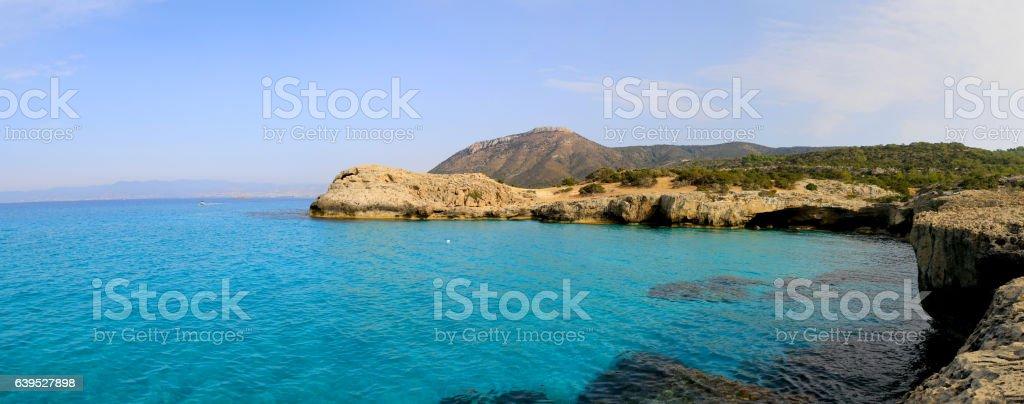 summer scene with rocky sea shore stock photo