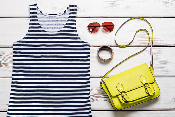 Summer sea top, bags and accessories for women. Summer sea top, bags and accessories for women. The new summer collection of clothing. sailor suit stock pictures, royalty-free photos & images