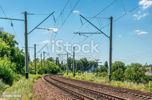 istock Summer Seasonal Rural Landscape and Suburban Railway 1298576254