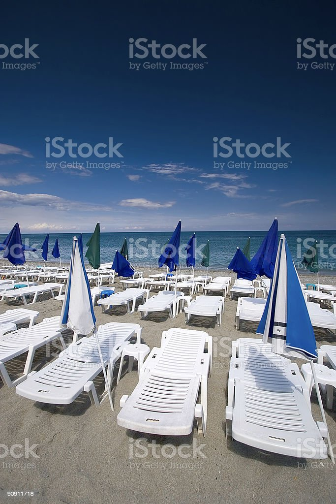 Summer seaview with deck-chairs and umbrellas royalty-free stock photo