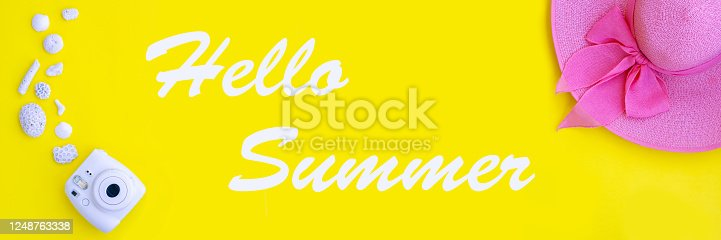 Summer set of beach items on a yellow background.