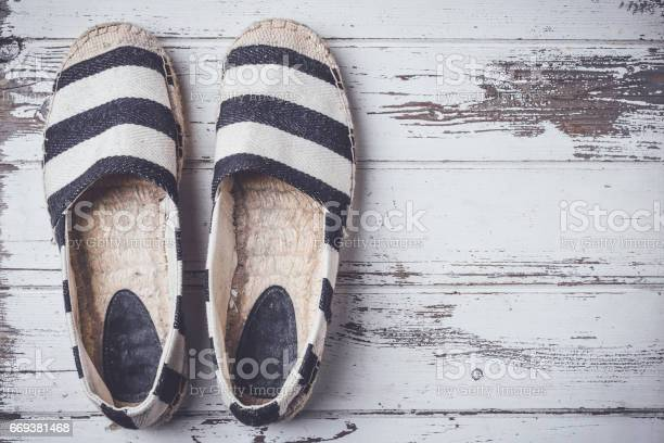 Summer shoes on white wooden floor picture id669381468?b=1&k=6&m=669381468&s=612x612&h=tl2mdai i6eiobb3tjllq0izvuxm6ltx p4ro69zxs4=