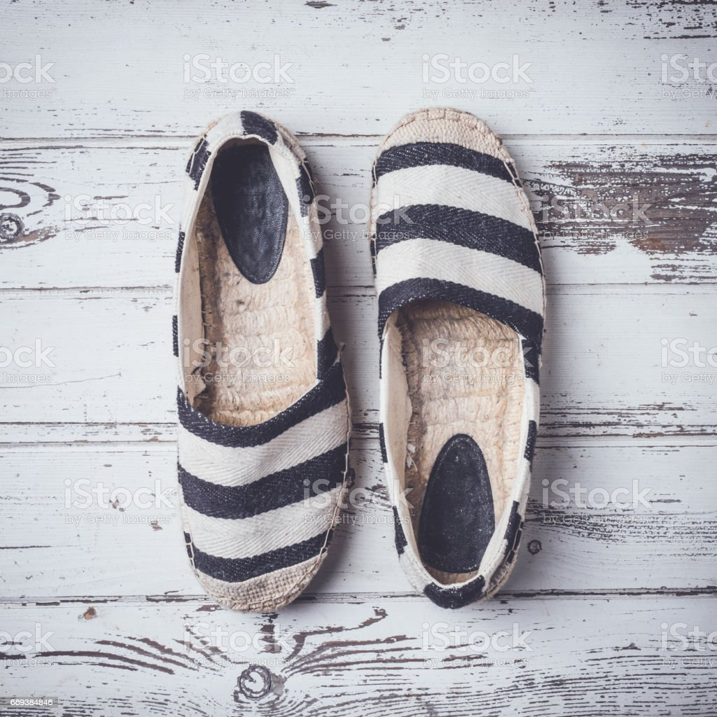 Summer shoes on white wooden floor stock photo