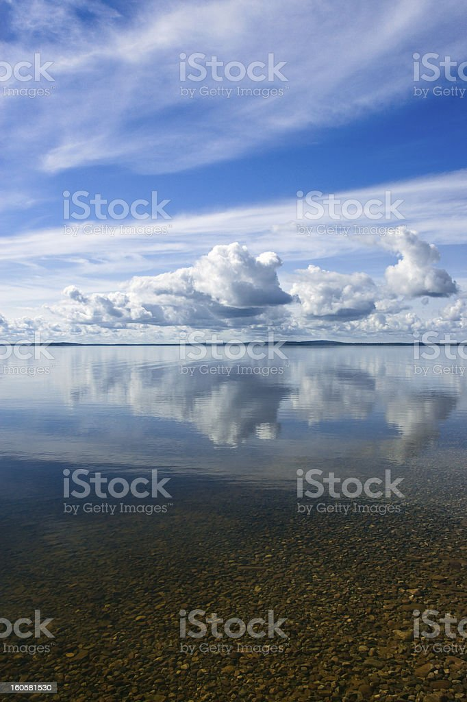 Summer Sky Reflecting in Lake stock photo