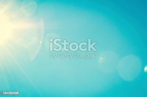 istock Summer sky with light flares 184260008