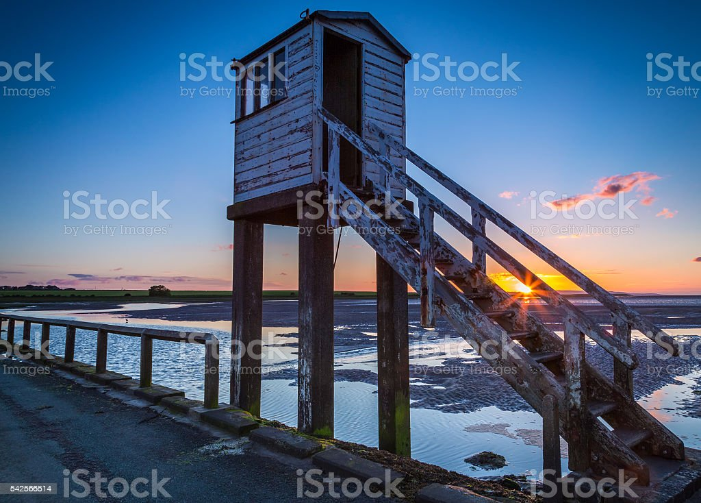 Summer Solstice sunset on Holy Island, England stock photo