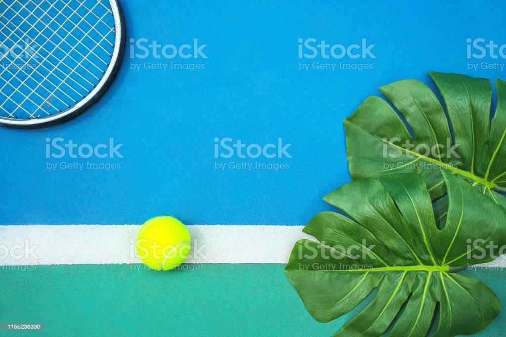 Summer sport concept with green monstera leaf and tennis ball,...