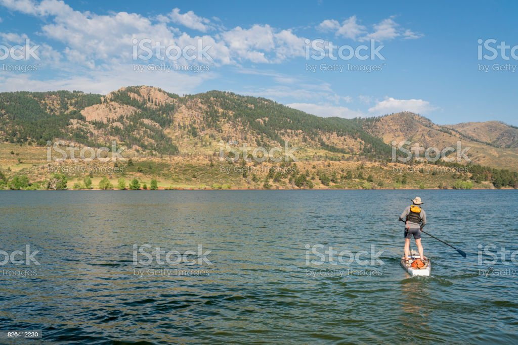 summer stand up paddleboard on lake in Colorado stock photo