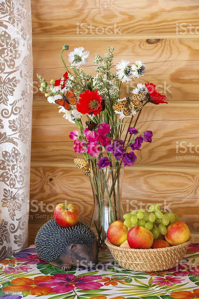 Summer still life and hedgehog with apple royalty-free stock photo