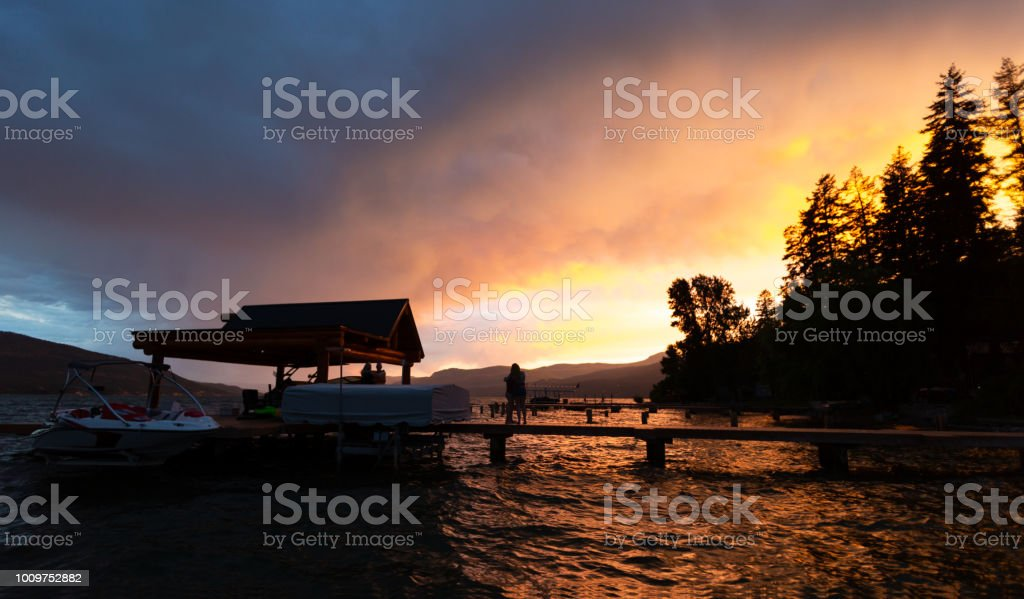 Summer Stormy Sunset at the Lake stock photo