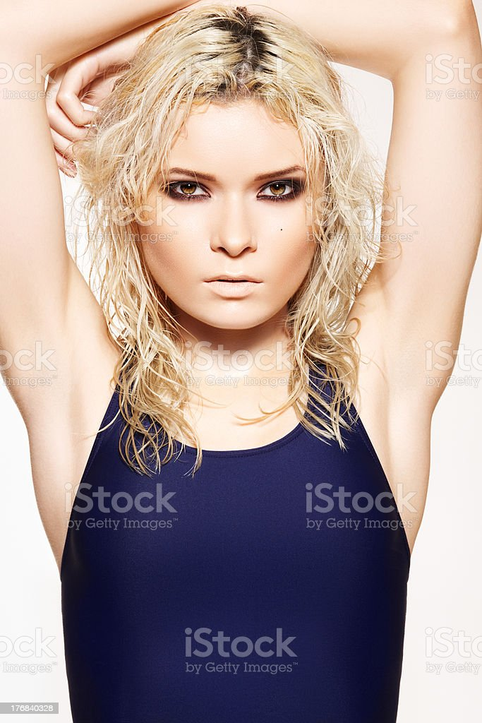 Summer style, wet hair. Woman in sport swimsuit royalty-free stock photo