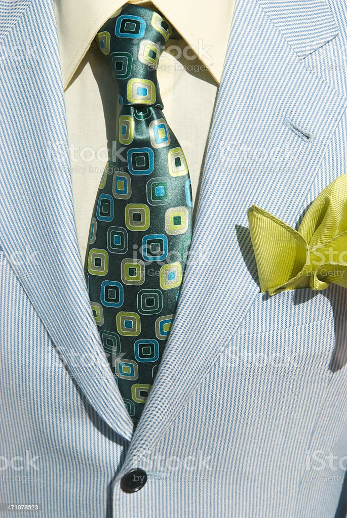 Light seersucker style suit gets a blast of color with a shiny tie...