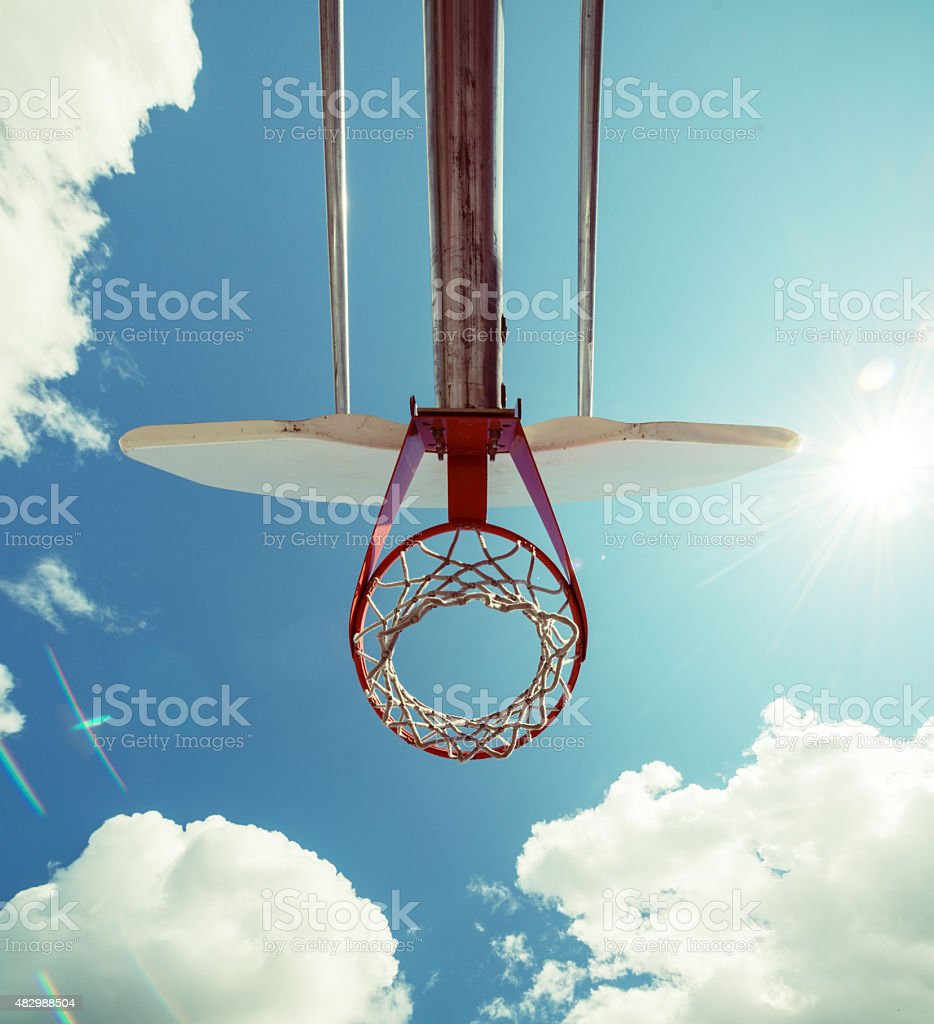 Summer Sun on Basketball Court stock photo