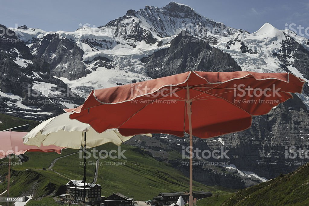 Summer sun shades green meadows with mountain royalty-free stock photo