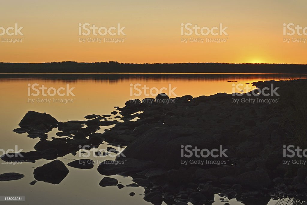 Summer sunset by a lake stock photo