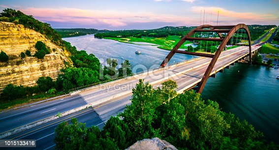 501329818istockphoto Summer Sunset Colorful Sky Over Austin , Texas at Pennybacker Bridge Panoramic Panorama 1015133416