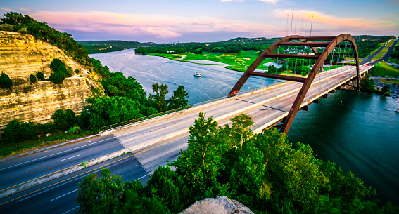 501329818 istock photo Summer Sunset Colorful Sky Over Austin , Texas at Pennybacker Bridge Panoramic Panorama 1015133416