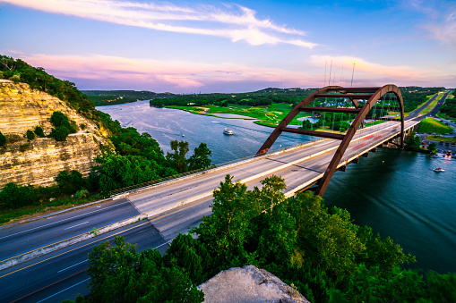 501329818 istock photo Summer Sunset Colorful Sky Over Austin , Texas at Pennybacker Bridge 1015133428
