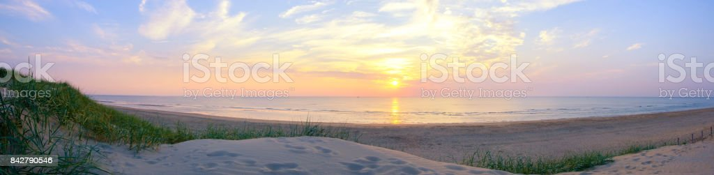 Summer sunset in the dunes at the North Sea Beach stock photo