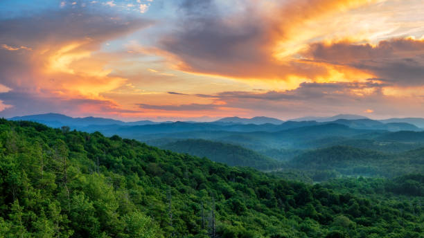 summer sunset off the blue ridge parkway at the flat rock overlook - mountain range stock photos and pictures