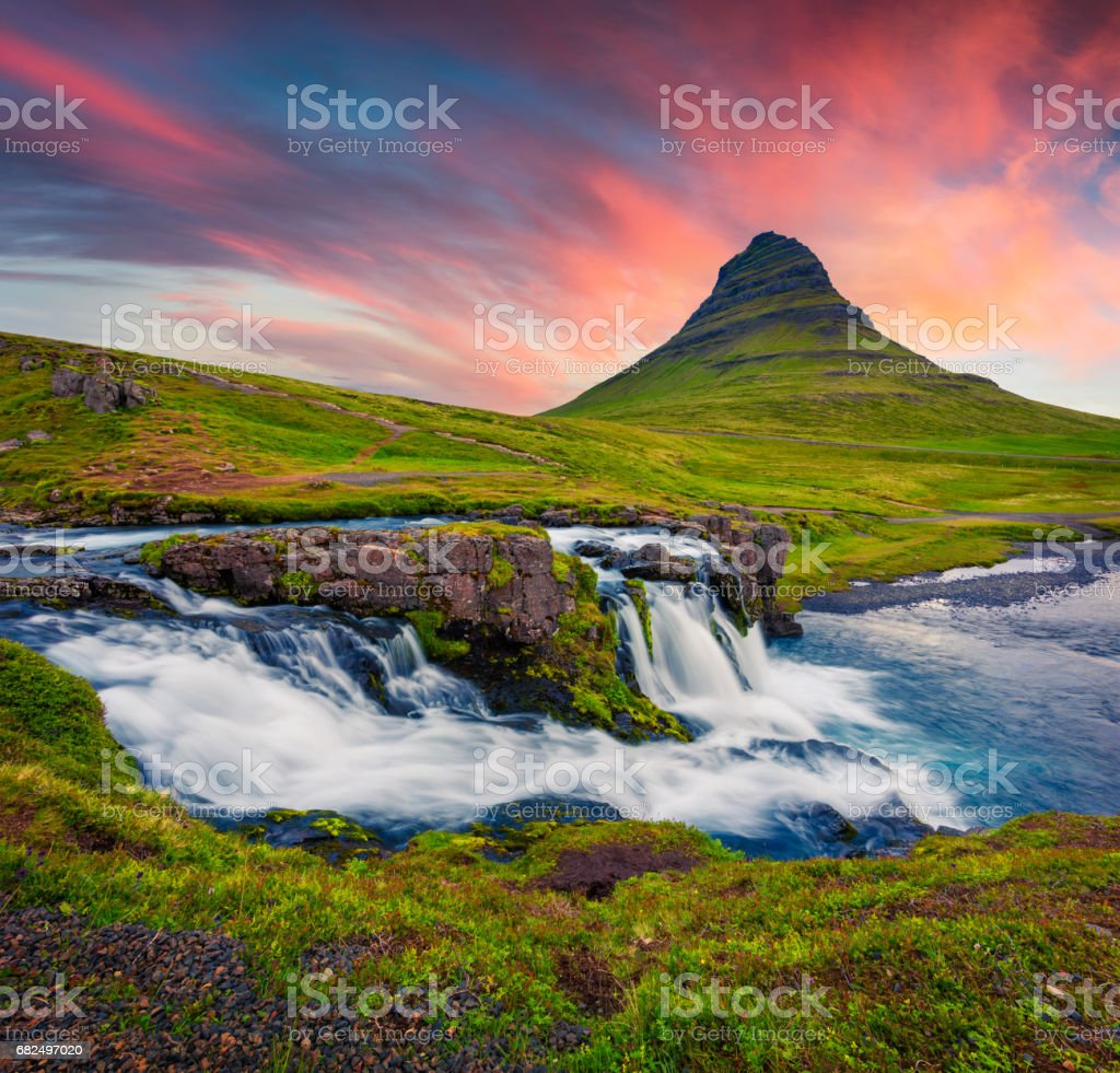 Summer sunset on famous Kirkjufellsfoss Waterfall and Kirkjufell mountain. royalty-free stock photo
