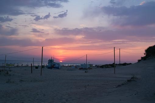istock Summer sunset on the sandy beach of the Black Sea 895155994
