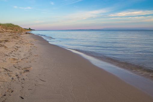 Summer Sunset Over A Wide Sandy Beach