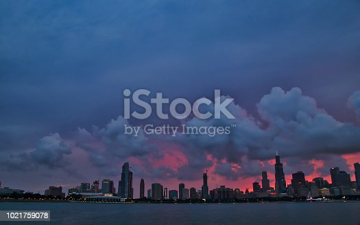 Summer sunset over Chicago's skyline and museum campus, seen from Lake Michigan.