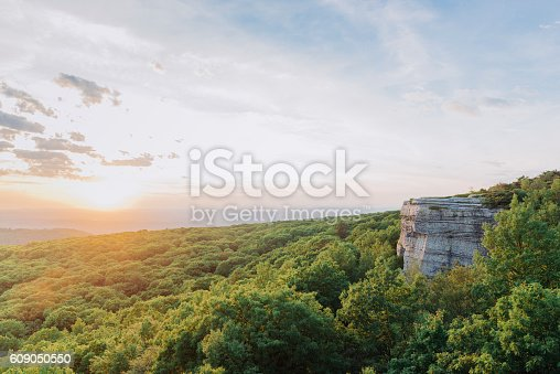 This is a horizontal, color, royalty free stock photograph of a scenic mountain sunset over the valley viewed from Sam's Point in Minnewaska State Park located in Ulster County in the Catskill region of upstate New York. Photographed with a Nikon D800 DSLR camera in summer.