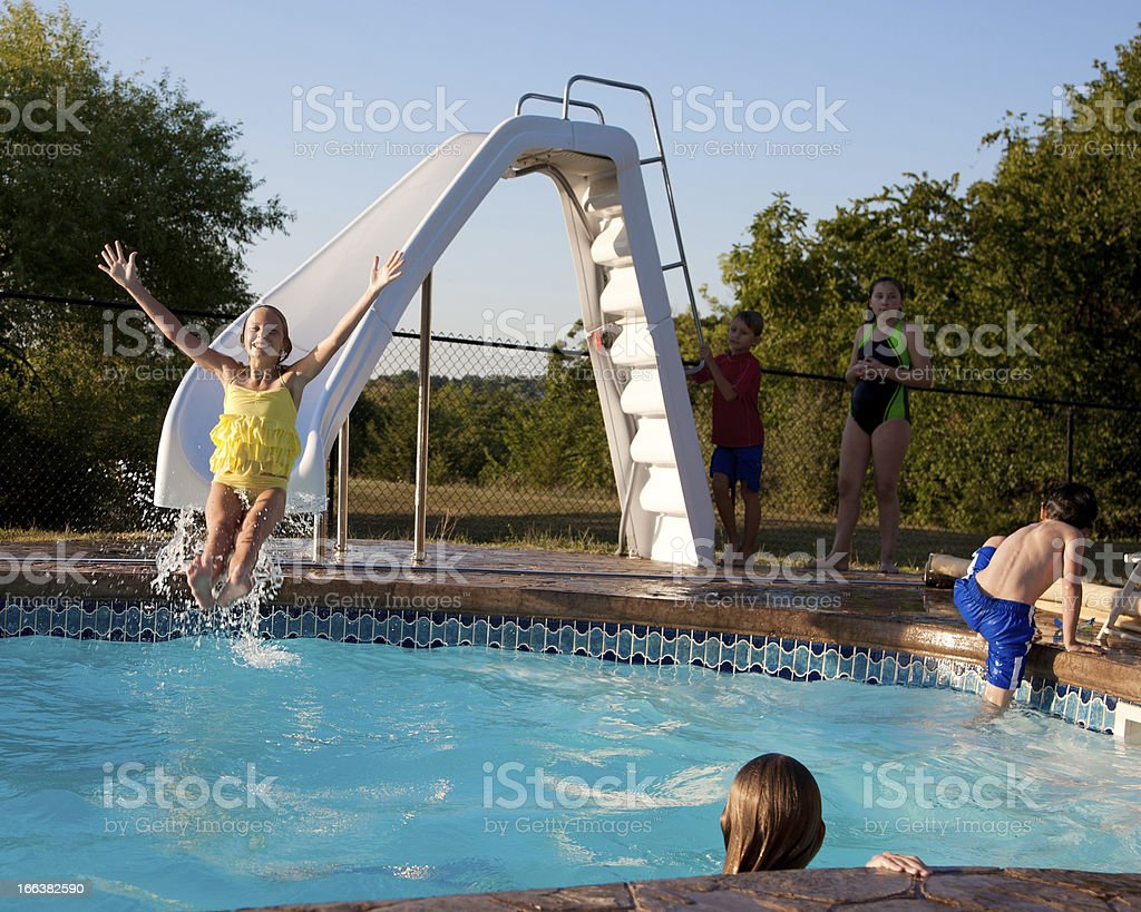 Summer Swimming: Group Children Playing Water Slide  Outdoor Pool stock photo