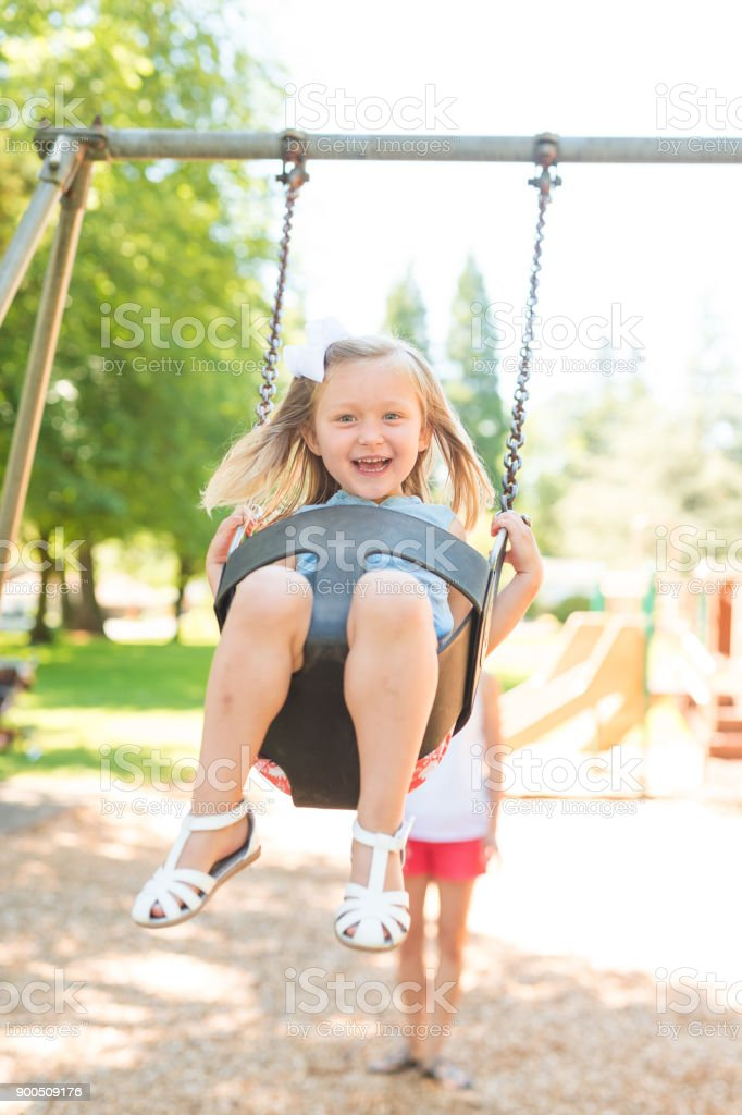 Summer Swinging at the Neighborhood Playground! stock photo