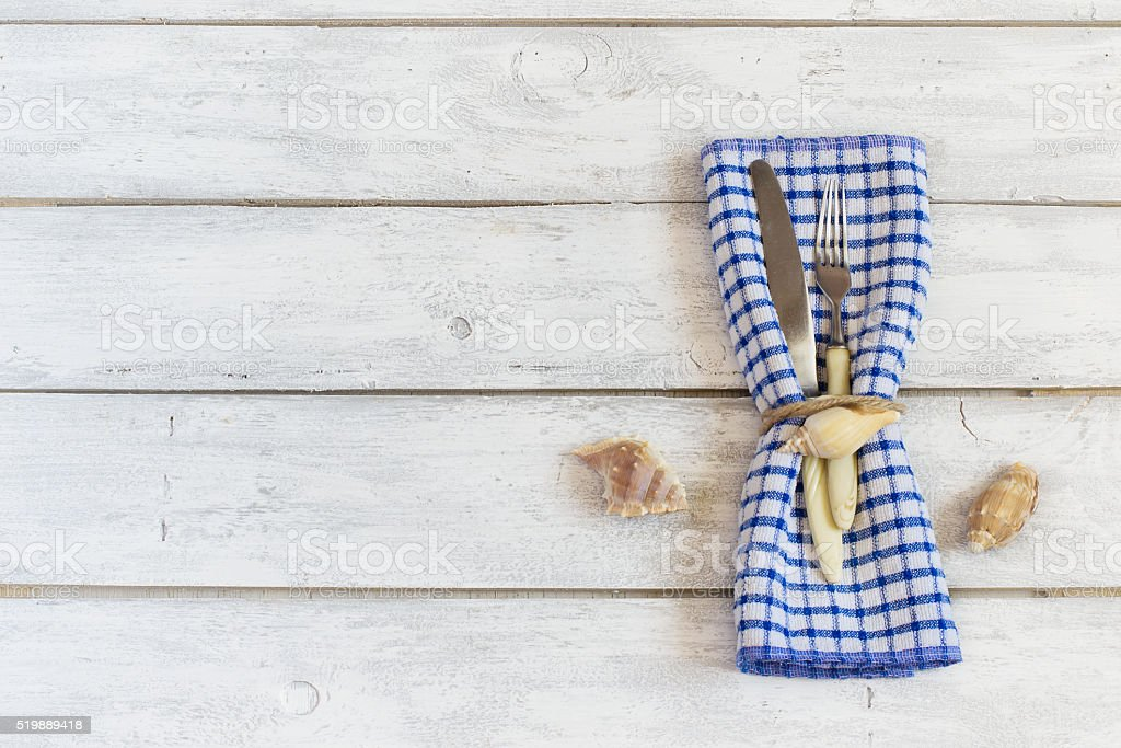 Summer table setting in a nautical theme stock photo