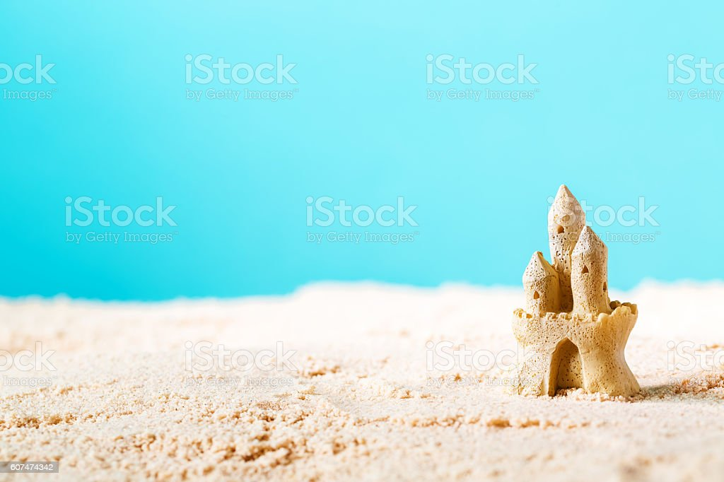 Summer theme with sand castle stock photo