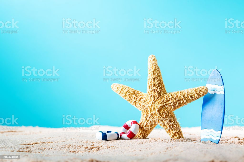 Summer theme with starfish and surfboard stock photo