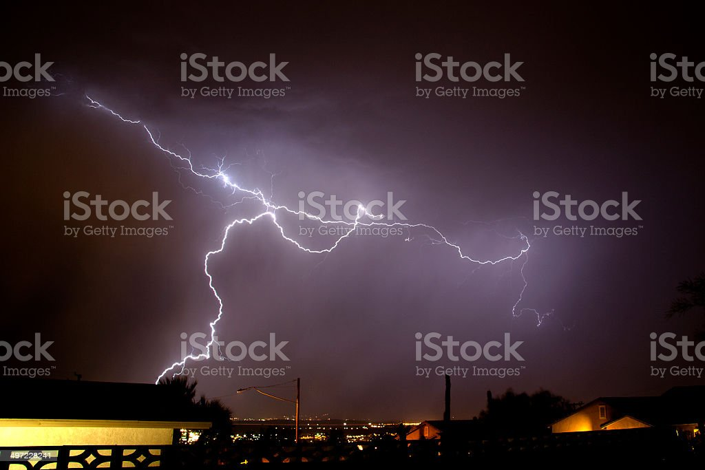 Summer thunderstorm in the desert, rope lightning stock photo