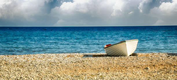 Summer time, travel concept, small fishing skiff stock photo