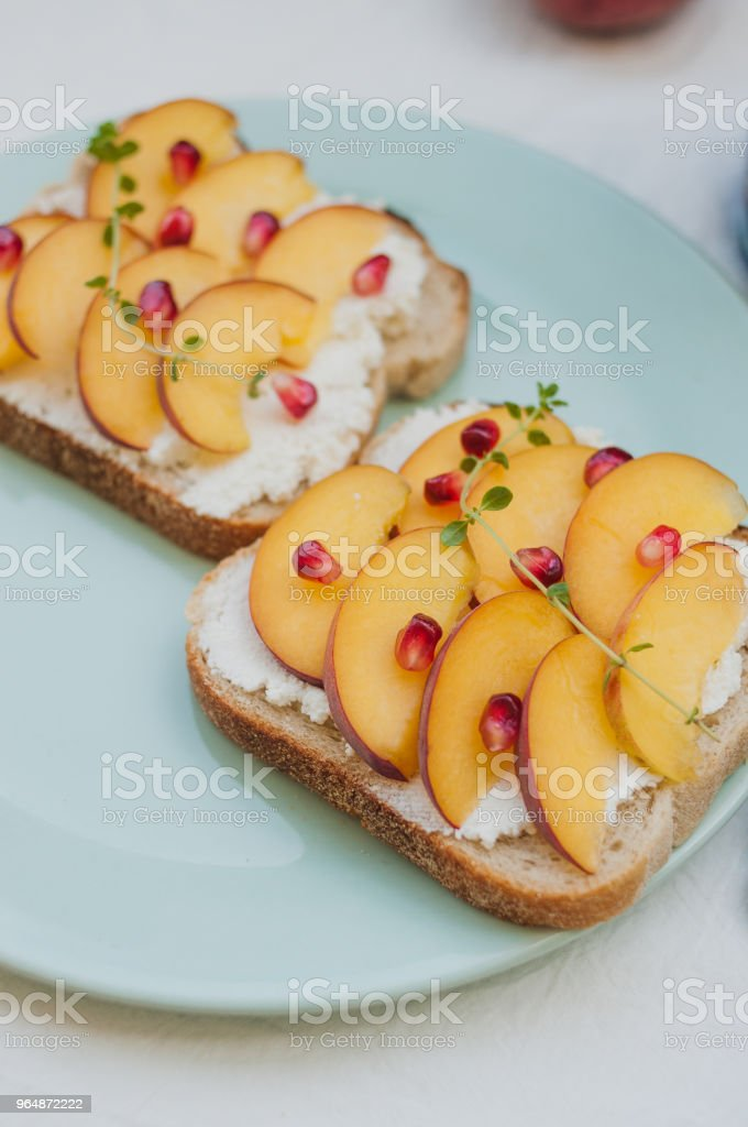 Summer toasts ricotta and peach royalty-free stock photo