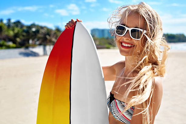 Summer Travel Beach Vacation. Happy Woman With Surfboard. Summer stock photo