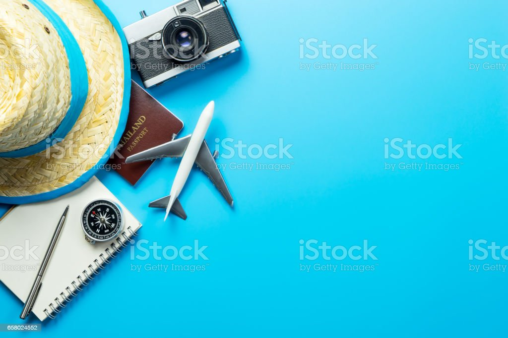 Summer travel blogger accesories on blue copy space stock photo