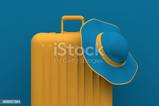 istock Summer Travel concept, hat and suitcase on blue background 958552564