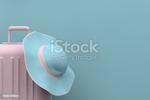 istock Summer Travel concept, hat and suitcase on blue background 958558664